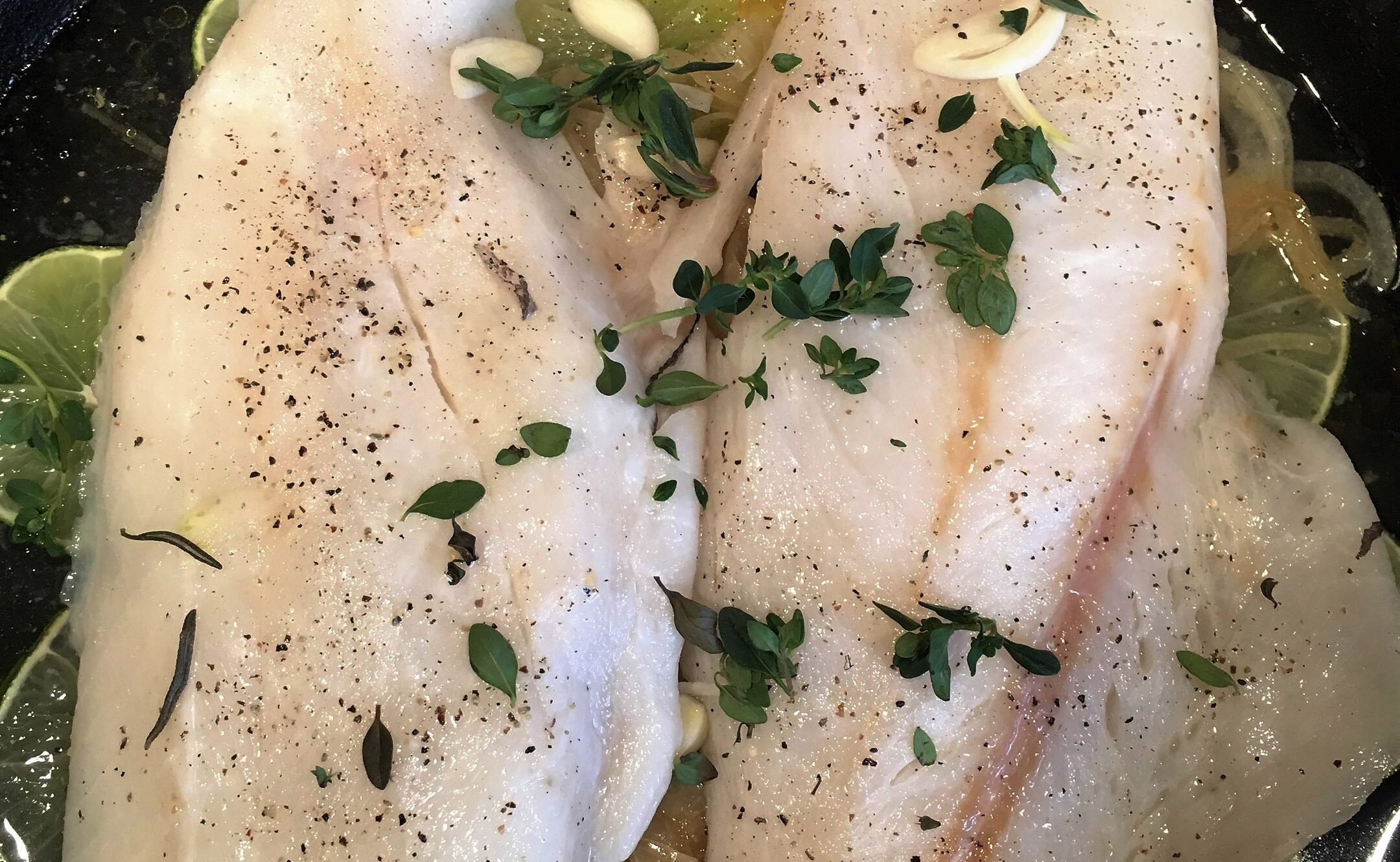 Dover Sole with Caramelized Onions in a skillet