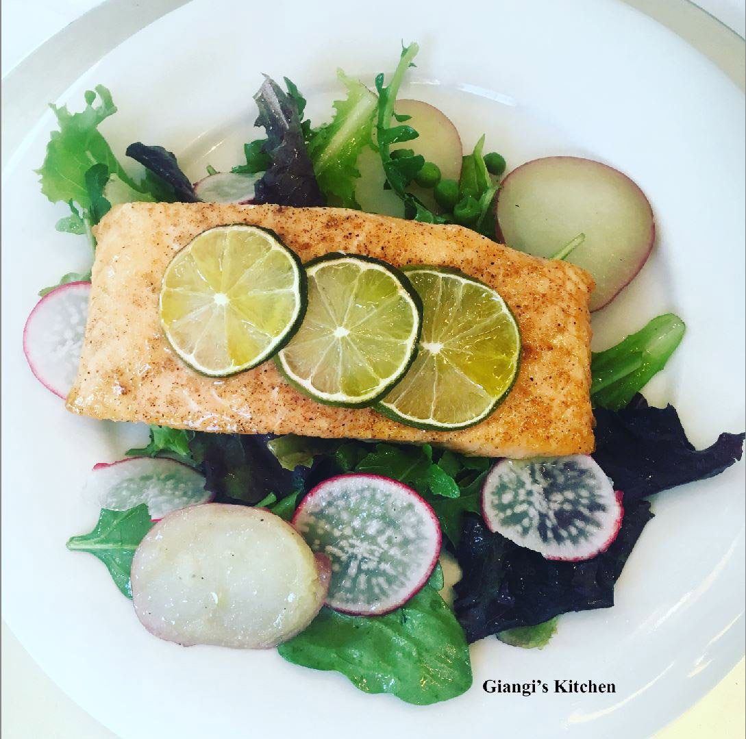 Salmon fillets with baby greens and arugual salad