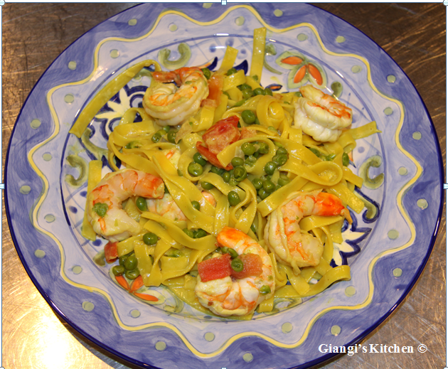 fettuccine with prawns, peas, tomatoes and cream sauce