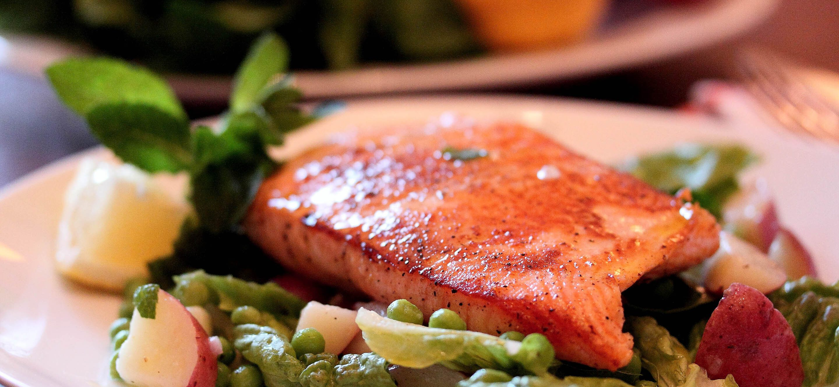 Seared salmon with peas, potatoes and mint.