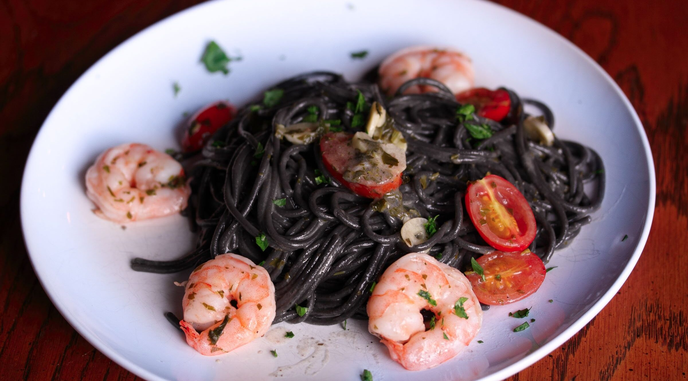 ink pasta with shrimps, tomatoes and garlic