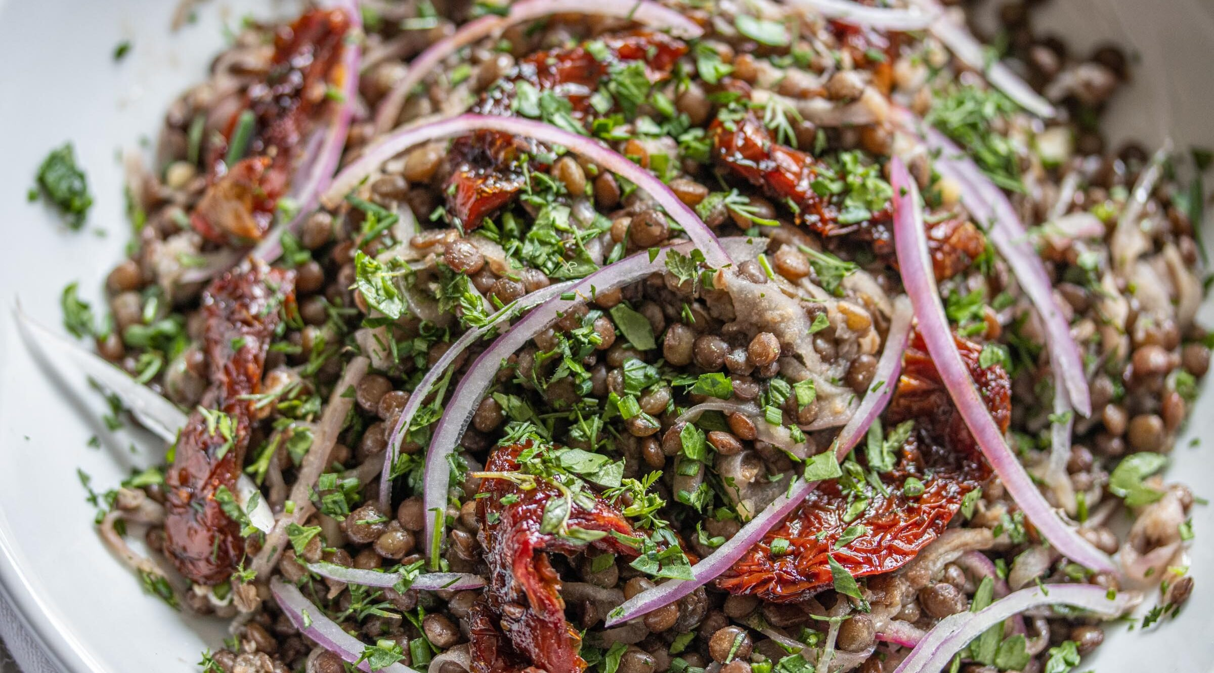 lentils with sun-dried tomatoes, onion and fresh herbs